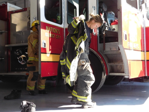 Firefighters Abby Taylor and Ryan Costeira suit up on January 25 at the St. Augustine Fire Department before heading out to a mock call.
