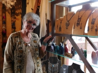 Sheila hurried around the Golden Gypsy, showing off each one of her creations.