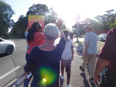 People of all ages came out to walk with the mayor on Tuesday, leading her through the streets and waving at passing cars.