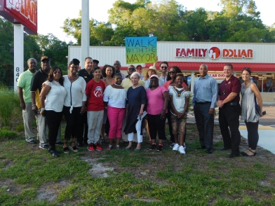 The group posed for a picture at the end of the walk in front of the family dollar.
